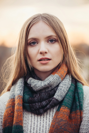 Beautiful young woman face with blue eyes on subset Stock Photo