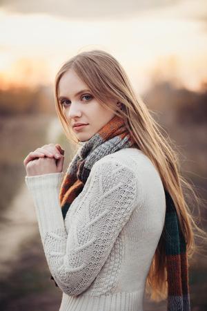 beautiful sad: Portrait of beautiful sad woman in autumn season. Soft sunny colors Stock Photo