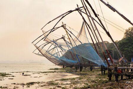 kochi: Chinese fishing nets on sunset background  in Cochin Kochi, Kerala, India
