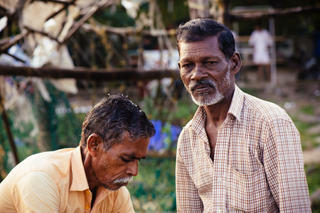 hardly: Kochi, India - November 29, 2015: Traditional technology of fishing. Fishermen hardly working on Chinese fishing net on the sea beach in Fort Kochi Cochin, Kerala, India. Editorial