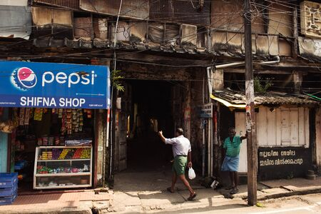kochi: Kochi, India - November 28, 2015: Street scene of indian people life in Mattancherry district, Kochi Cochin, Kerala, India Editorial