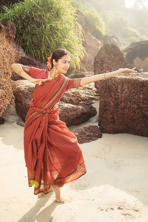 bharatanatyam: Indian classical dance Bharatanatyam performed by beautiful woman in traditional clothing