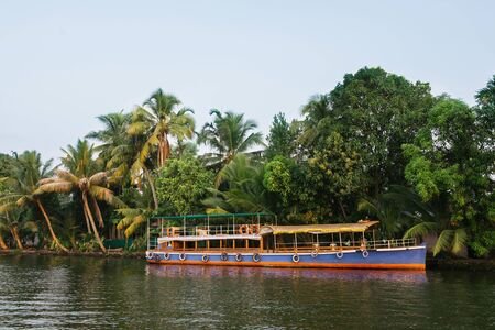 backwaters: Traditional tourist boats in Alleppey backwaters, Kerala, India Stock Photo