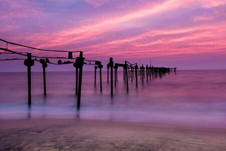 alappuzha: Long exposure sea pier in Alleppey beach with beautiful sunset, Kerala, India Stock Photo