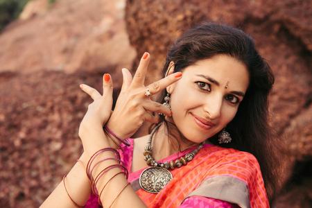 varkala: Beautiful indian woman in red saree dancing traditional Bharatanatyam dance Stock Photo