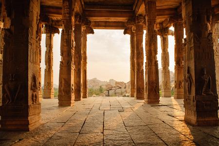 karnataka culture: Beautiful columns architecture of ancient ruins of temple in Hampi, Karnataka, India