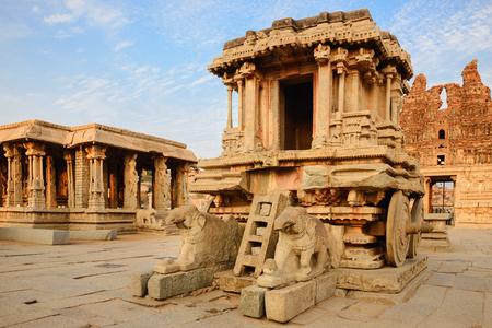 karnataka culture: Stone chariot in courtyard of Vittala Temple at sunset in Hampi, Karnataka, India Stock Photo