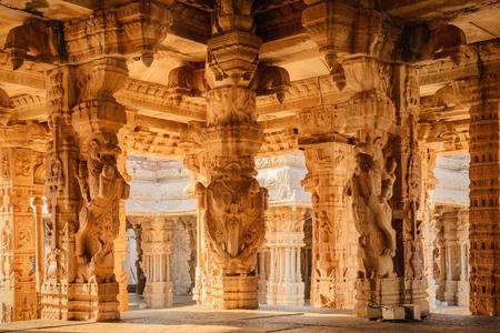 karnataka culture: Beautiful columns architecture of ancient ruins of Vittala temple in Hampi, Karnataka, India
