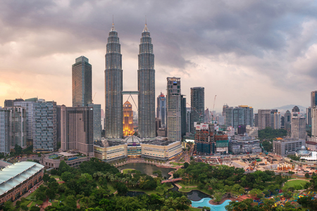 megalopolis: Kuala Lumpur, Malaysia - March 16, 2016: Panorama of Kuala Lumpur Petronas towers. Urban asian megalopolis on sunset, Malaysia Editorial