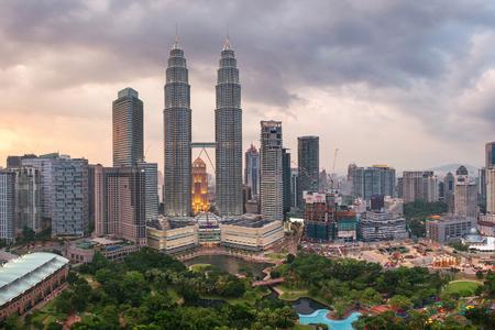 Kuala Lumpur, Malaysia - March 16, 2016: Panorama of Kuala Lumpur Petronas towers. Urban asian megalopolis on sunset, Malaysia Editorial