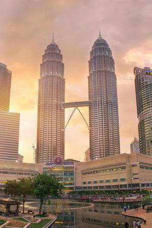 megalopolis: Kuala Lumpur, Malaysia - March 14, 2016: Panorama of Kuala Lumpur Petronas towers. Urban asian megalopolis on sunset, Malaysia
