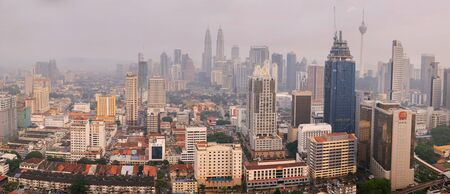 megalopolis: Kuala Lumpur, Malaysia - March 18, 2016: Panora of foggy Kuala Lumpur cityscape. Urban asian megalopolis in the evening covered with smog