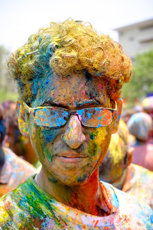 shree: Kuala Lumpur, Malaysia - March 26, 2016: Man portrait during Holi Festival of Colors. Indian people celebrate holi in other country in Shree Lakshmi Narayan temple in Kuala Lumpur. Holi is a spring festival celebrated as a festival of colours.