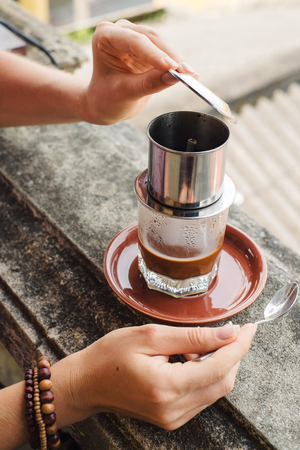 hoi an: Traditional method of making of vietnamese coffee. Hoi An, Vietnam Stock Photo