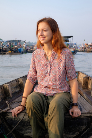 can tho: Woman tourist riding on a boat on Cai Rang floating market, Can Tho, Vietnam