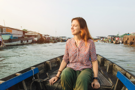 cai rang: Woman tourist riding on a boat on Cai Rang floating market, Can Tho, Vietnam