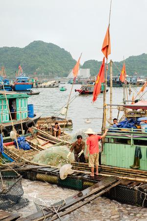 ba: Cat Ba, Vietnam - April 10, 2016: Fishing port and fishery on Cat Ba Island in Ha Long Bay, Vietnam Editorial