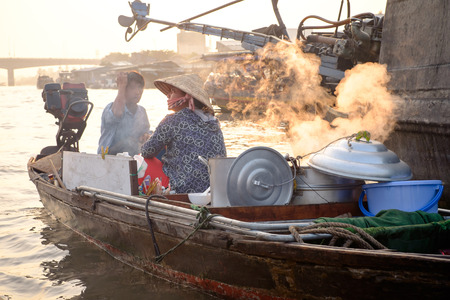 cai rang: Can Tho, Vietnam - April 2, 2016: Boat cafe on Cai Rang floating market in the Mekong Delta river at sunset time