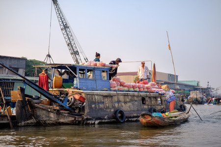 cai rang: Can Tho, Vietnam - April 2, 2016: Unidentified people on Cai Rang floating market in the Mekong Delta river selling fruit and vegetable