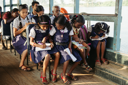 Alleppey, India - January, 28, 2016: Indian children get to school by boat in Kerala backwaters