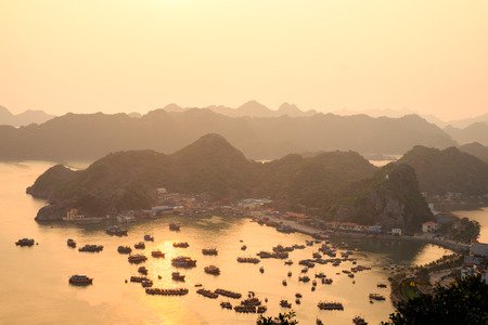 cat island: Port and fishing boats on Cat Ba island in Halong Bay at sunset from above