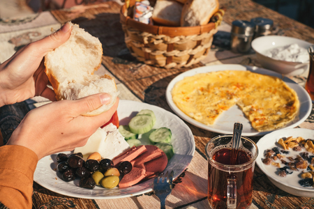 Traditional turkish food on breakfast from omelet, tea, olives, cheese and bread