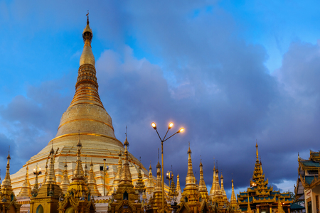 Shwedagon pagoda and buddhist temple in beautiful twilight, Yangon, Myanmar Stock Photo