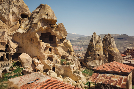 Turkish Urgup village in Cappadocia region with old cave houses, Turkey Stock Photo