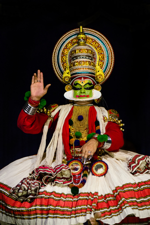Cochin, India - January 23, 2016: Kathakali performance in Cochin Kochi temple festival. Indian Kathakali dancer, Kerala, Fort Kochi. Kathakali is one of the oldest classical dance forms of Kerala and
