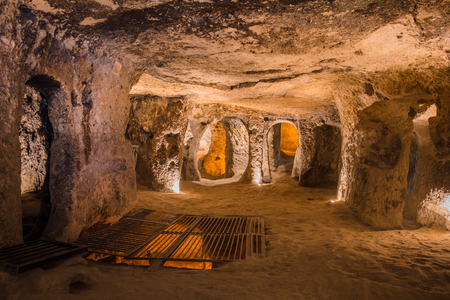 Explore Kaymakli ancient multi-level underground cave city in Cappadocia, Travel to Turkey. Stock Photo
