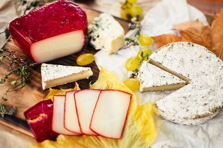 Set of aged Cheese, brie, camembert with fruit and herbal on wooden and craft paper background Stock fotó - 135958504