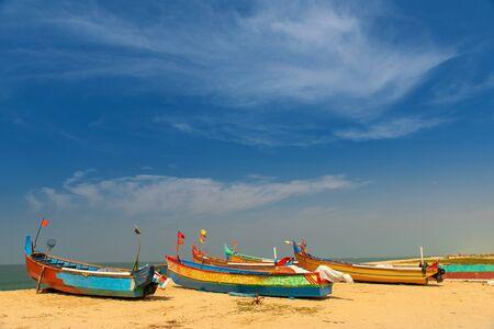 Colorful fishing boats on the Varkala beach on sunset Kerala, India Reklamní fotografie