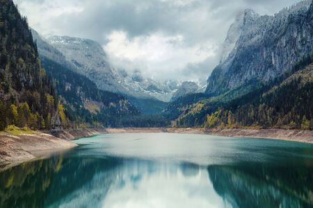 Alpine lake with dramatic sky and mountains