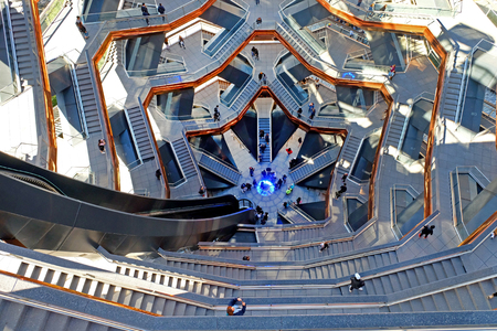New York - October 10, 2019: Looking down into The Vessel, Hudson's Yard, Manhattan, the elaborate honeycomb like structure rises 16 stories, 154 flights of stairs and 2,500 steps and 80 landings for visitors to climb, in Hudson's Yard, Manhatten. 新闻类图片