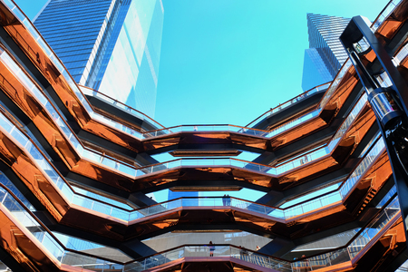 New York - October 10, 2019: The Vessel, looking up from the centre, the elaborate honeycomb like structure rises 16 stories, 154 flights of stairs and 2,500 steps and 80 landings for visitors to climb, in Hudson's Yard, Manhatten.
