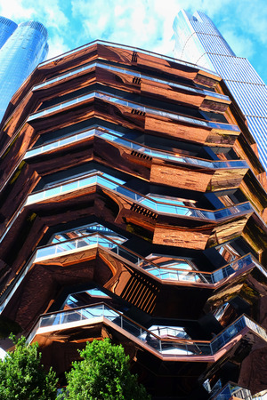 New York - October 10, 2019: The Vessel, the exterior of the structure, the elaborate honeycomb like structure rises 16 stories, 154 flights of stairs and 2,500 steps and 80 landings for visitors to climb, in Hudson's Yard, Manhatten.