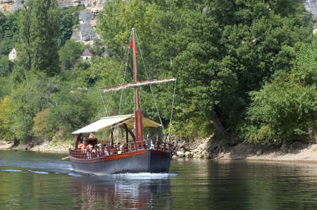 A walk in boat on the Dordogne on board traditional boatscalled barges or gabarres