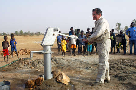 humanitarian aid: Water is not surfaces some in Africa, but with 40 meters under ground. Humanitarian associations finance and make install pumps in order to draw this water for the life of the village.