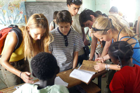 Visit French schoolboys in Burkina Faso Faso in a school of a village. Exchanges are done between the small French and the small Africans for better understanding the differences in life between them. Stock Photo - 11556236