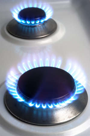 The gas butane or burning hot propane gas on a cooker photo