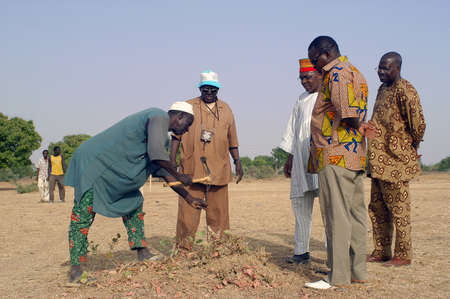 African waterfinder with work in an area of Burkina Faso Faso. Stock Photo - 16286866