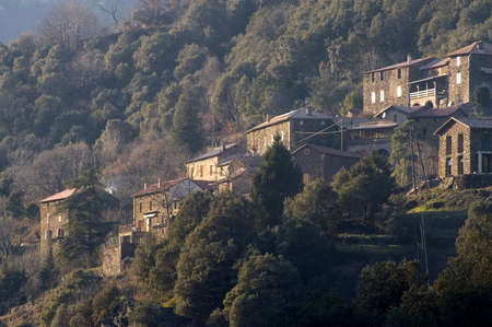 mediterrean: landscape of the Cevennes, detached houses in the mountain. Stock Photo