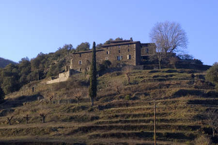 roussillon: landscape of the Cevennes, detached houses in the mountain. Stock Photo
