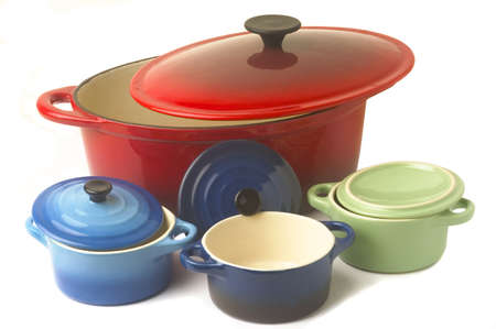 Mini casseroles individual which makes it possible individually to simmer a dish while adding an original character to the presentation. Stock Photo - 16293074