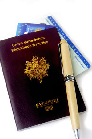 biometric French passport in studio on white zone photo