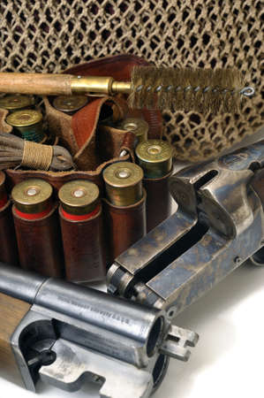 shotgun and its cartridges. Still life representing hunting. photo