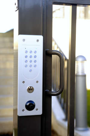 lock  futuristic: door code of entry from building modern and nine on the wicket giving on the street