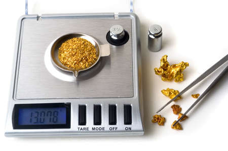 Weighing of gold Stock Photo - 17466166