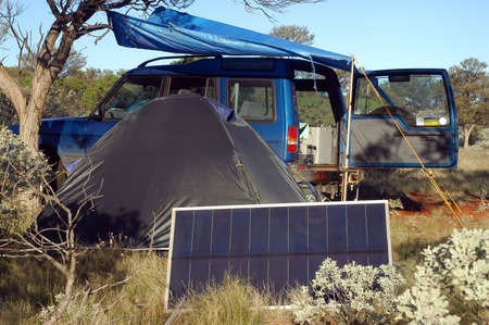 Camping in the Australian bush with solar panels to reload the batteries Stock Photo
