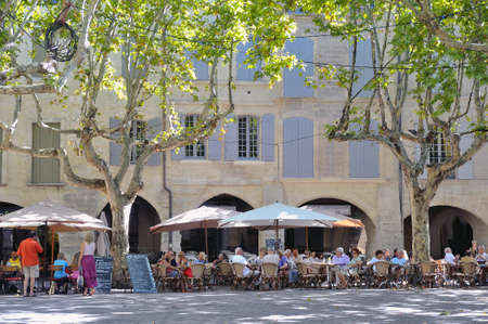 be in hiding of restaurant on a place of Uzes